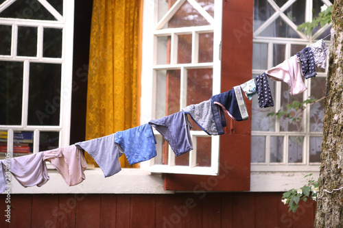 Fototapety, obrazy: drying kids pants on rope