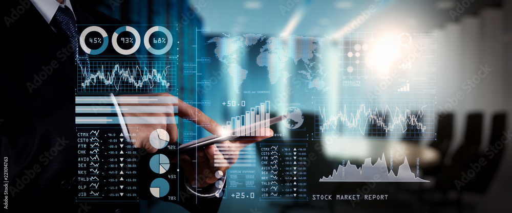 Fototapeta Investor analyzing stock market report and financial dashboard with business intelligence (BI), with key performance indicators (KPI).businessman hand working with finances program.