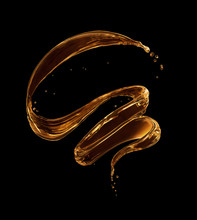 Splashes Of Oily Liquid In A Swirling Shape On A Black Background