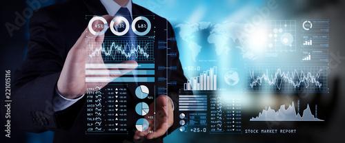 Fototapeta Investor analyzing stock market report and financial dashboard with business intelligence (BI), with key performance indicators (KPI).businessman hand working with finances program  obraz