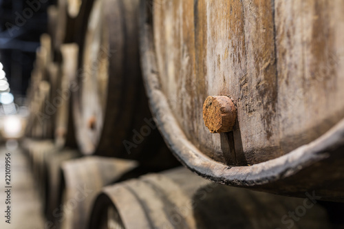 Fotografia  Cork of a wooden porto wine barrel in wine cellar of Porto, Portugal