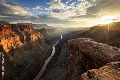 Spoed Foto op Canvas Chocoladebruin Golden sunset rays in the Grand Canyon, Arizona, USA.