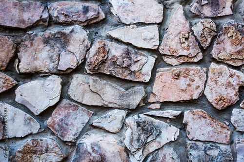 Close up of natural stone wall. Stone wall texture