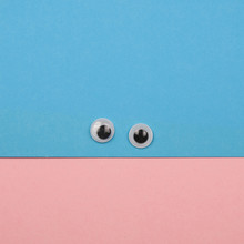 Creative Minimal Paper Smile Face With Plastic Toy Eyes Pastel Colors Flat Lay Square