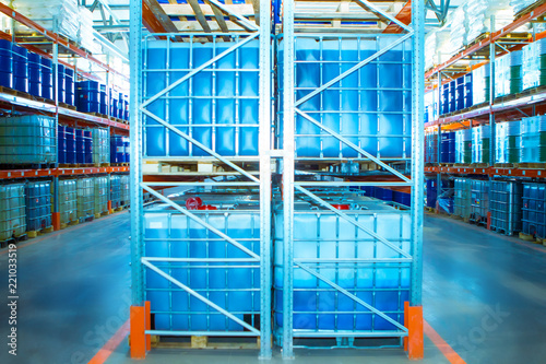 Plastic Barrels. Warehouse of chemical products. Stelazhy with barrels. Chemistry. Manufacture of chemicals. Pallets with barrels. Storage of chemicals.