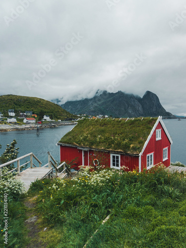 Garden Poster Scandinavia Norway traditional architecture house rorbu and rocky mountains scandinavian travel view landscape, Lofoten islands in Norway