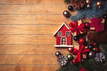 Little Wooden House And Christmas Decoration On Wooden Table. Above View In Old Color Style