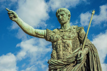 Caesar Augustus, The First Emperor Of Ancient Rome. Bronze Monumental Statue In The Center Of Rome, With Clouds