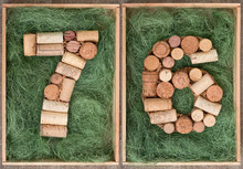 Number 76 Seventy Six  Made Of Wine Corks On Green Background In Wooden Box