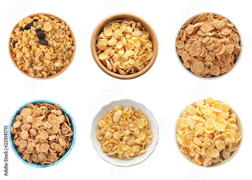 Set with bowls of breakfast cereals on white background, top view. Healthy whole grain recipe
