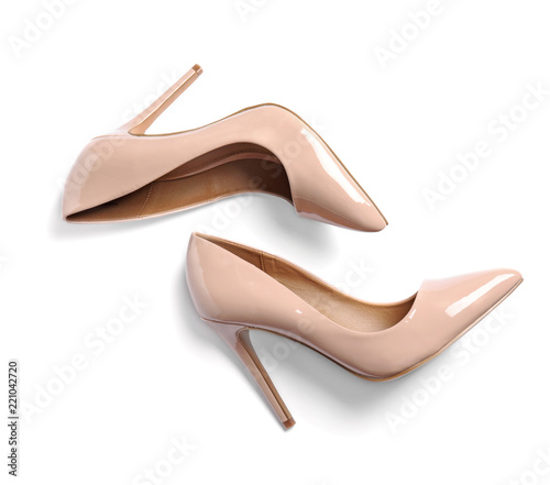 Pair of beautiful shoes on white background, top view