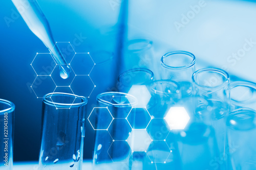 Dropping chemical liquid to test tube, laboratory research and development concept Canvas Print