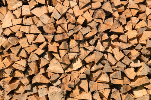 Foto op Canvas Brandhout textuur Firewood logs background