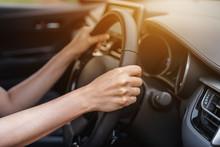 Hand Driving On Steering Wheel In Car