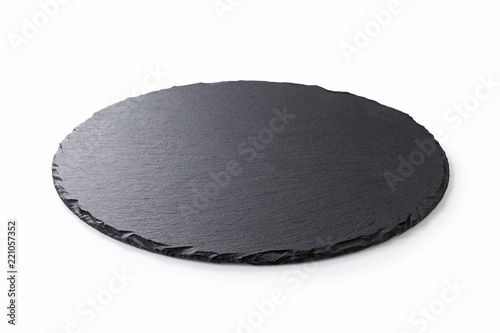Black round stone plate with white background Fototapeta