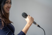 Speaker At Conference Holding Microphone In The Hand In Thailand