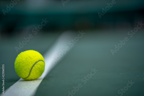 Fotomural The beginning of a champion, Close up tennis ball on the courts background