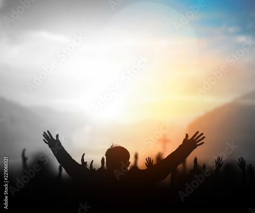 Leinwand Poster Praise and worship concept:Silhouette of Christian prayers raising hand while pr