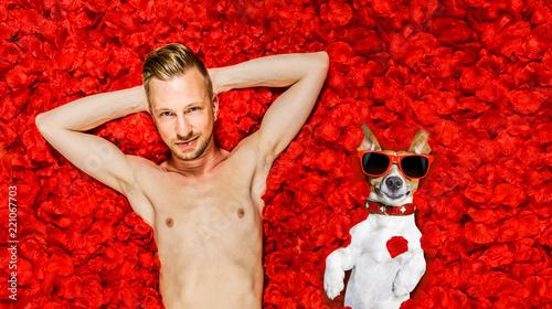 Foto op Aluminium Crazy dog sexy man in petal roses bed