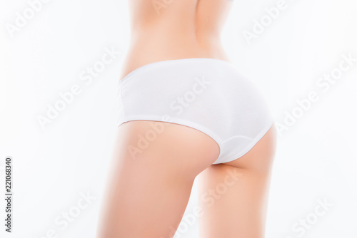 Deurstickers Ezel Close up photo of fit woman's ass with perfect ideal skin in whi