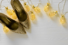 Womens Gold Chunky Glitter Pumps. Shoes For Wedding, Christmas, New Year, Evening, Cocktail, Night Out. Golden Stiletto Heels. Flat Lay. Footwear On White Wooden Background With Copy Space
