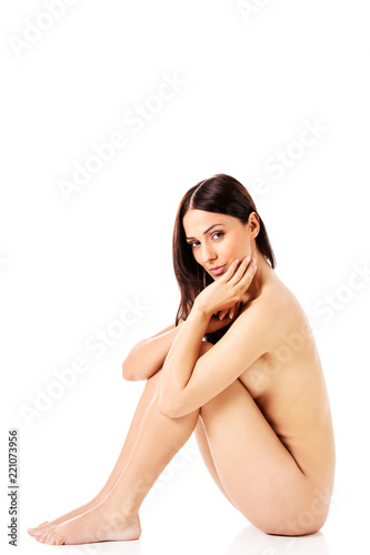 Tuinposter Akt Young nude woman sitting on the floor