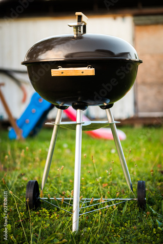 Deurstickers Grill / Barbecue Kettle Charcoal BBQ Barbecue Grill in garden or backyard.