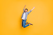 Leinwanddruck Bild - Full-size portrait of happy excited young man screaming and jump