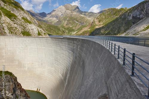 Poster Dam Llauset dam in Aragon. Hydroelectric power. Trekking route. Spain
