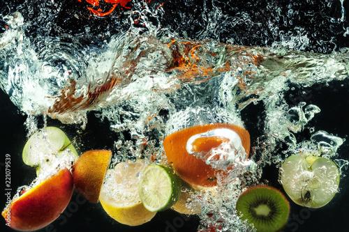 Printed kitchen splashbacks Splashing water many fruits splashes into water