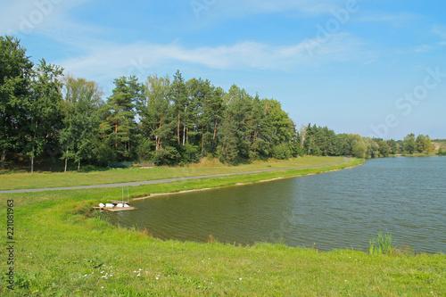 Fotografie, Obraz  nice pond with the trees on its bank in summer, Brusperk, Czech Republic
