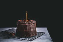 Chocolate Birthday Blackout Cake With A Burning Candle