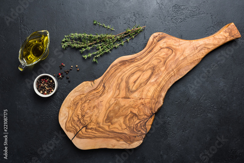 Cuadros en Lienzo Olive wood cutting board, spices and herbs for cooking