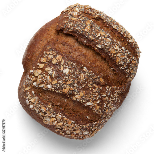Deurstickers Brood A loaf of buckwheat bread on a white background