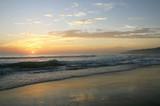 Fototapeta Morze - Beautiful sunset on Karon beach. The surf pounds the shore. Phuket, Thailand
