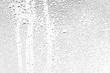 Leinwanddruck Bild - texture of a drop of rain on a glass wet transparent background