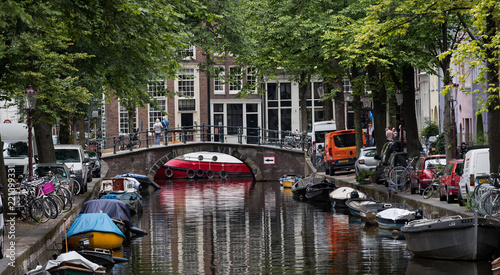 Photo  Amsterdam, Netherlands - August 2018: a shady corner on the canals of Amsterdam