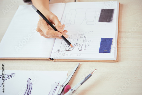 Crop Hand Of Fashion Designer Drawing Sketches Of Stylish Clothes Near Samples Of Fabric In Open Notebook Buy This Stock Photo And Explore Similar Images At Adobe Stock Adobe Stock