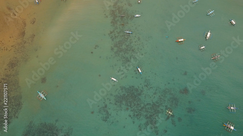 Aerial view of sailing boats and yachts in the bay. Boat and yacht in the tropical lagoon. Aerial view: tropical landscape. Philippines, El Nido. Travel concept.