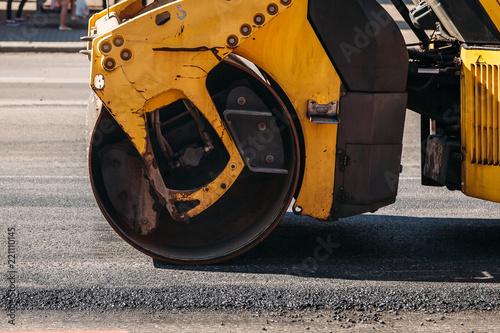 Road roller building the new asphalt road at a road