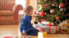 Little Toddler Boy Sitting Und...