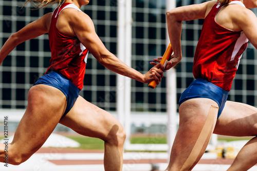 Cuadros en Lienzo relay race passing of baton women team runners