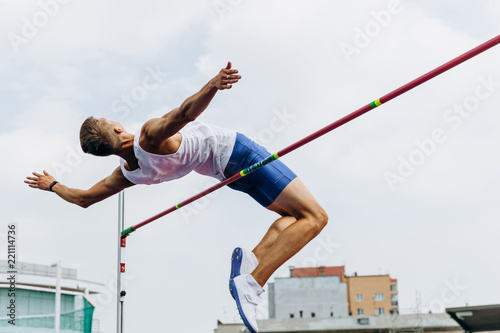 high jump athlete jumper successful attempt in competition Canvas Print