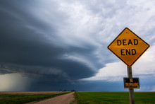 """Rotating Storm Moves Past """"dead End"""" And """"no Trespassing"""" Signage On Prairie Northeast Of Big Springs, Nebraska"""