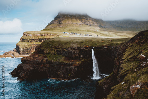 Coastal cliff with waterfall