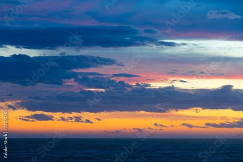 Peaceful sky with cloud breaks above ocean