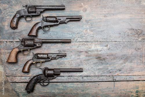 Pinturas sobre lienzo  Armory display of historic guns and pistols