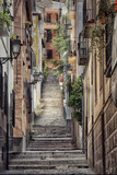 Fototapeta  - Old street with stairs in Granada in Spain.