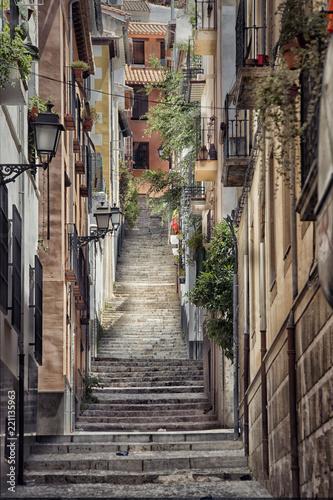 Fototapeta Old street with stairs in Granada in Spain. obraz