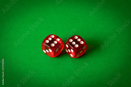 Foto  Dice on a green background . Game concept. Games of chance